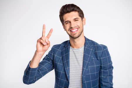Portrait of charming man make v-signs wear modern plaid blazer jacket isolated over white background