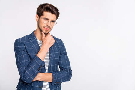 Portrait of his he nice attractive calm content top executive director ceo boss chief recruiter wearing checked blazer touching chin thinking copy space isolated over light white pastel background