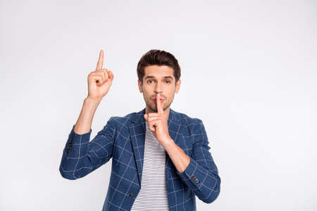 Portrait of his he nice attractive luxury corporate stylish businessman agent broker wearing checked blazer showing shh sign symbol pointing up isolated over light white pastel background Standard-Bild - 131313308