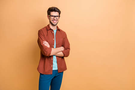 Portrait of his he nice attractive content successful cheerful cheery brown-haired guy professional finance expert shark folded arms isolated over beige color pastel background