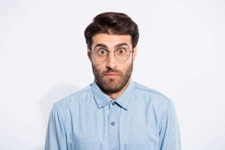 Close up photo of amazing indian guy looking big eyes feel guilty blamed for awful situation wear specs casual denim shirt isolated white color background Фото со стока