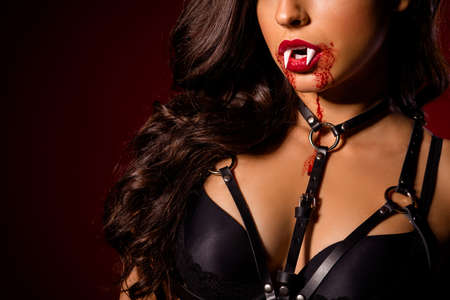 Cropped close-up view portrait of her she nice bloody cruel evil alluring dominant black brunette wavy-haired girl Dracula costume isolated on dark red maroon burgundy marsala color background