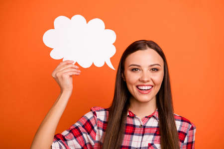 Share your point of view with us. Closeup photo of pretty cute excited dreamy teenager expressing her feelings by language holding white speech bubble in hand isolated bright background
