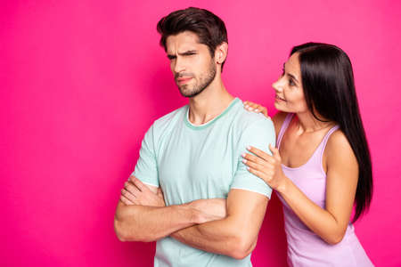 Photo of funny couple guy blaming lady in cheating standing angry and mad waiting apologizing wear casual clothes isolated vibrant pink color background