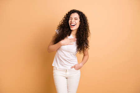 Photo of amazing lady listening great humorous story holding hand on chest laughing out loud wear white casual clothes isolated beige pastel color background