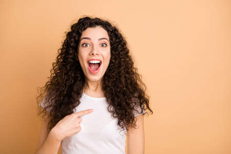 Photo of white ecstatic charming attractive beautiful girl pointing at herself surprised about being chosen isolated over beige pastel color background