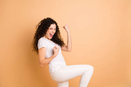 Profile photo of amazing yelling lady triumphing raising fists sale shopping prices beginning wear white casual clothes isolated beige pastel color background 스톡 콘텐츠
