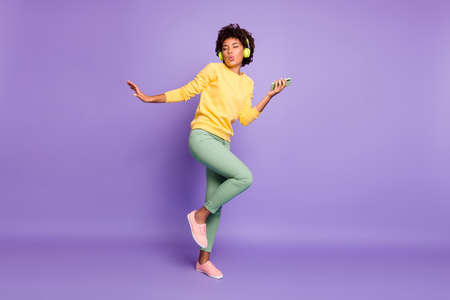Full length body size view of nice attractive charming dreamy funky funny cheerful wavy-haired girl listening soul dancing having fun isolated over violet purple lilac pastel color background