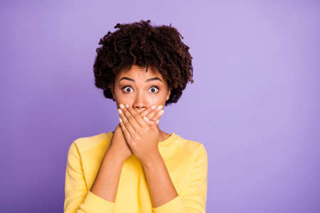 Close-up view portrait of her she nice attractive charming lovely funny wavy-haired girl closing covering mouth mute hush shush isolated over violet purple lilac pastel color background Banque d'images