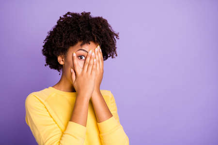 Close-up portrait of her she nice attractive charming lovely shy scared, wavy-haired girl closing hiding face peeking isolated over violet purple lilac pastel color background Stok Fotoğraf