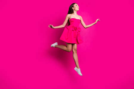 Full length body size view of her she nice attractive gorgeous fascinating carefree cheerful long-haired girl flying having fun isolated on bright vivid shine vibrant pink fuchsia color background