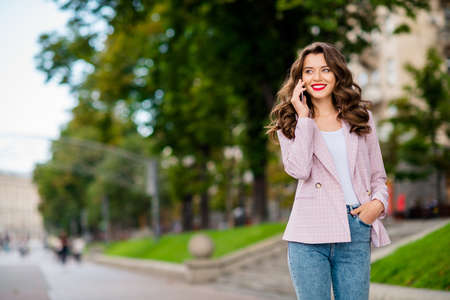 Portrait of her she nice-looking attractive charming lovely cheerful cheery wavy-haired lady traveling calling home abroad in park outdoors