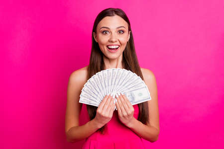 Close-up portrait of her she nice attractive glad cheerful cheery impressed long-haired girl holding in hands large big fan budget isolated on bright vivid shine vibrant pink fuchsia color background