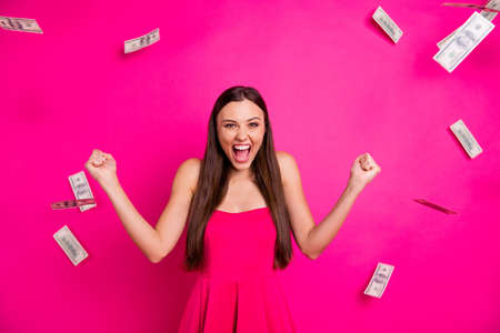 Portrait of her she nice attractive lovely gorgeous cheerful glad long-haired girl enjoying cash flow great jack pot winning isolated on bright vivid shine vibrant pink fuchsia color background 版權商用圖片