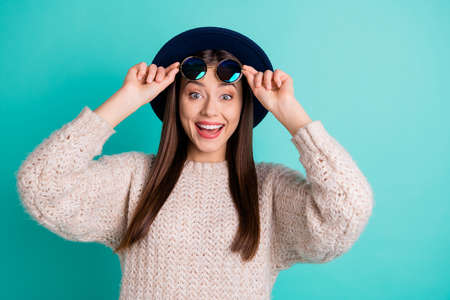 Portrait of impressed girl touch her specs try look unbelievable black friday bargain wear woolen jumper isolated over teal turquoise color background 写真素材