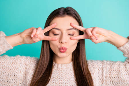 Close up photo of calm flirty lovely girl make v-signs send air kiss attract boyfriend have date wear pullover isolated over teal turquoise color background
