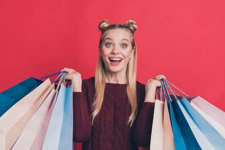 Purchase new collection duty-free travel concept. Closeup photo portrait of pretty charming cute hipster holding many packages with apparel isolated pastel color background