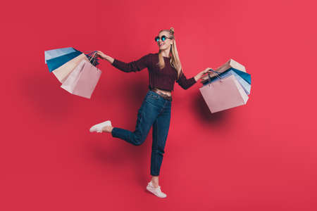 Black friday good mood concept. Full length photo of rejoicing optimistic cheerful gorgeous beautiful hipster in jeans denim outfit enjoying new clothes isolated pastel background