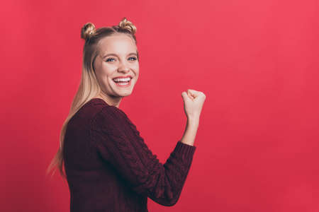 Profile photo of amazing lady overjoyed with great achievement raising fist air rejoicing football fan wear knitted jumper isolated pastel red color background