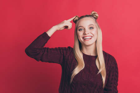 Closeup photo of pretty lady indicating finger on own head hairstyle advising attend cool stylist wear knitted burgundy pullover isolated pastel red color background