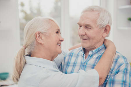 Photo of two pretty aged people pair feelings slow dance anniversary holiday celebration comfortable flat indoors Stock Photo