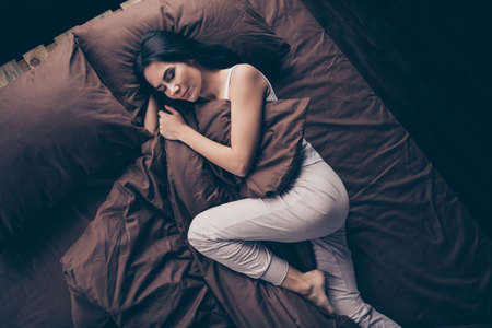 Top above high angle view portrait of her she nice-looking attractive lovely sleepy calm peaceful girl lying in bed sleeping dreaming in room flat apartment house indoors