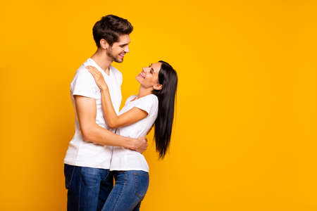 Photo of adorable pair slow dancing at prom night party looking eyes wear casual outfit isolated yellow color background