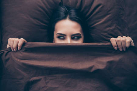 Close-up portrait of her she nice attractive lovely cute cheerful cheery girlish girl covering hiding face dark burgundy maroon veil peeking lying in bed in room flat house indoors Archivio Fotografico