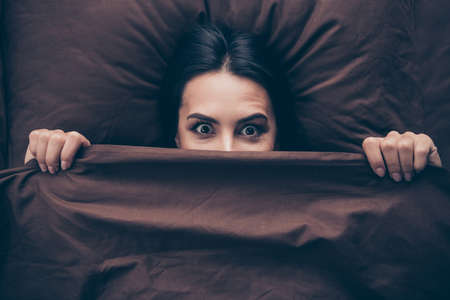Close-up portrait of her she nice attractive lovely cheerful cheery funny childish, girlish girl covering hiding face dark marsala burgundy maroon veil lying in bed in room flat house indoors
