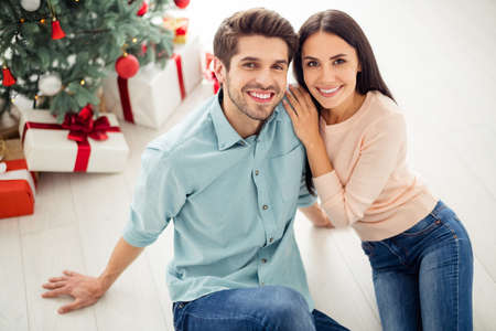 Top above high angle photo of two people cheerful man and woman sitting on white floor enjoy christmas time x-mas holidays in house indoors Stock fotó