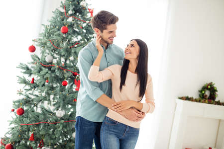Turned photo of two people romantic man feel romance enjoy christmas time x-mas holidays in house with newyear decoration indoors