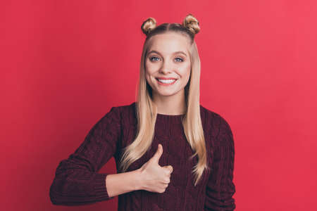 Photo of amazing pretty lady with funny hairstyle raising thumb up approving best quality of product wearing knitted pullover isolated pastel red color background