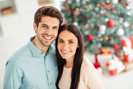 Close up photo of two people cheerful spouses feel romance enjoy christmas time x-mas holidays in house indoors