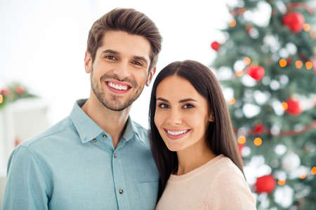 Close up photo of two people spouses feel romantic enjoy christmas holidays x-mas vacation in house with newyear decoration indoors
