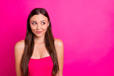 Close-up portrait of her she nice-looking attractive gorgeous lovely cheerful shy long-haired girl looking aside good idea isolated over bright vivid shine vibrant pink fuchsia color background