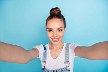 Close up photo of lovely cute nice girl taking selfie isolated with blue background having vacation fun holiday