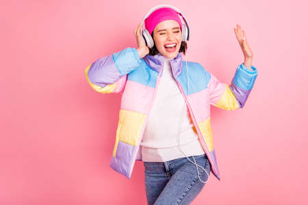 Portrait of her she nice attractive lovely cheerful cheery glad positive girl enjoying mp3 track audio player hobby free time isolated over pink pastel background