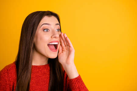 Photo of cute charming nice gorgeous youngster shouting at empty space to draw your attention to information notified isolated over vivid color background