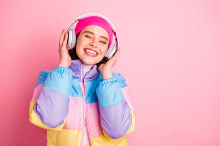 Close-up portrait of her she nice attractive lovely winsome cheerful cheery girl enjoying new cool track closed eyes isolated over pink pastel background Stock fotó