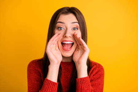 Photo of cute charming cheerful nice attractive fascinating youngster screaming new important information to you isolated over yellow vivid color background Banco de Imagens