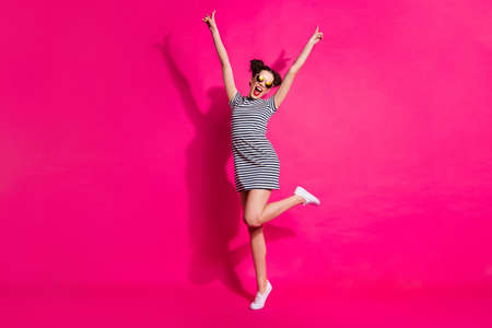 Full length body size view of her she nice attractive lovely cheerful cheery girl dancing having fun rising hands up isolated over bright vivid shine vibrant pink fuchsia color background