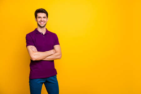 Portrait of his he nice attractive cheerful cheery content brown-haired guy folded arms copy space isolated over bright vivid shine vibrant yellow color background