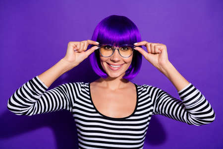 Photo of beautiful lady showing new specs amazing sight wear wig striped pullover isolated purple background