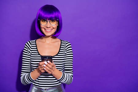 Photo of satisfied lady holding hands new telephone glad to get purchase wear specs striped pullover isolated purple background