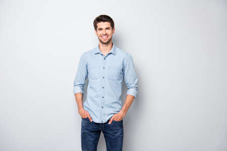 Portrait of positive cheerful dreamy emotions man have fun free time with his colleagues after work put hands pockets wear casual style clothing isolated over grey color background