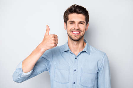 Portrait of positive cheerful man show thumb-up recommend ads sales discounts wear casual style outfit isolated over grey color background