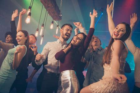 Portrait of cheerful positive high-school friends people gathering celebrate university graduation having fun on dance floor girlfriends boyfriends wear formalwear dress skirt outfit in nightclub