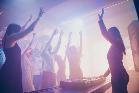 Dj mc pj performing loud stereo sound rhythm trance techno electronic style, set music disc for stylish cheerful positive crowd having fun weekend at fashionable modern nightclub
