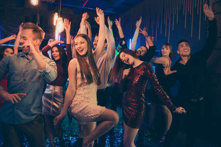 Portrait of cheerful group of people mates dancing in nightclub have, fun on noel discotheque wear formalwear dress skirt Фото со стока