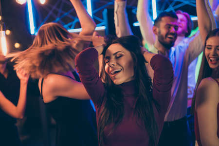 Omg its wonderful. Portrait of ecstatic girl have fun enjoy party nightclub dance touch her brown hair scream feel rejoice wearing formalwear outfit in discotheque